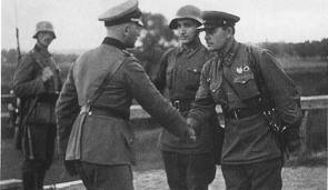 German and Soviet officers shake hands at the end of the invasion  of Poland, public domain photo, the Soviet Tass Press Agency,  September, 1939.