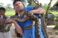 That's me in Thailand with a couple of pythons, apparently well fed.